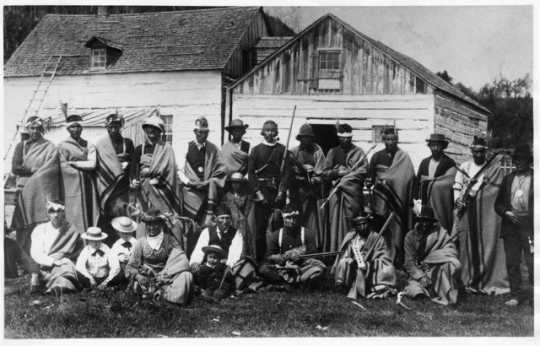 Black and white photograph of Ojibwe at Grand Portage Reservation, 1885.