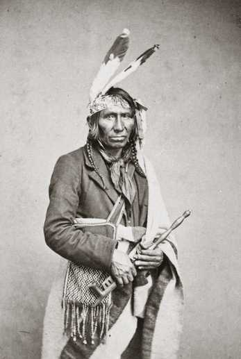 Black and white photograph of Iaweshowewekesik (Crossing the Sky), 1863. Iaweshowewekesik was a leader of the Gull and Rabbit Lake Ojibwe.