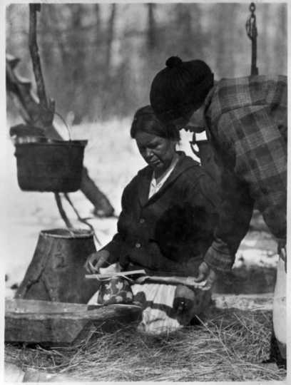 Um-be-quay (Mrs. John Mink) making maple sugar