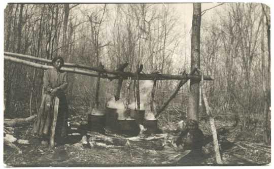 Ojibwe women making maple sugar at Cass Lake