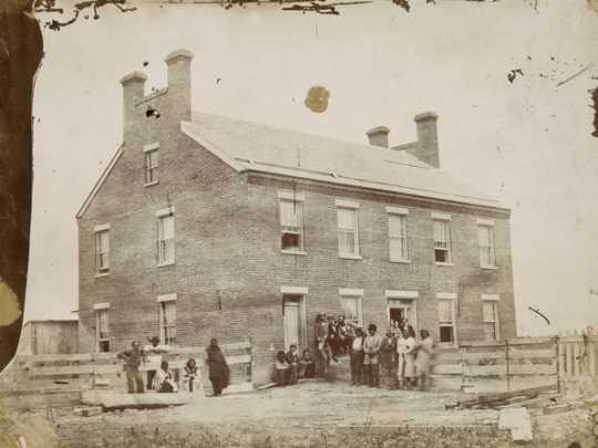 Black-and-white photo print of the Ho-Chunk (Winnebago) Indian Agency, c.1860.