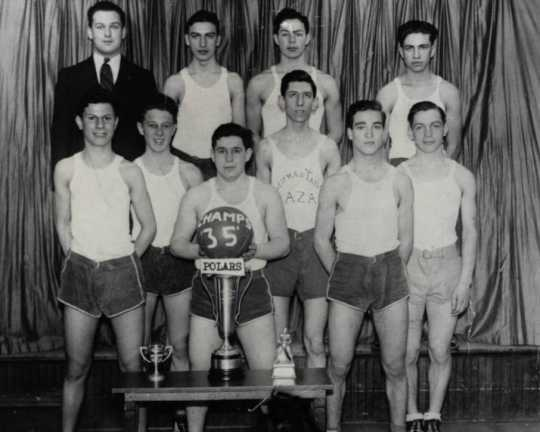 Black and white photograph of the Polars Club basketball team, sponsored by the Emanuel Cohen Center in North Minneapolis, 1935.