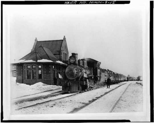 Duluth & Iron Range Railroad Locomotive #46 (built in 1888) with log train at Endion Depot.