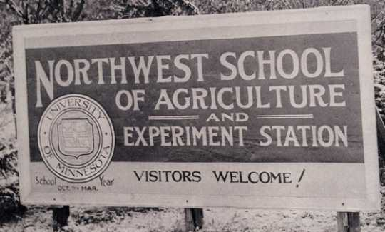 Black and white photograph of the entrance sign for the Northwest School of Agriculture and Northwest Experiment Station.