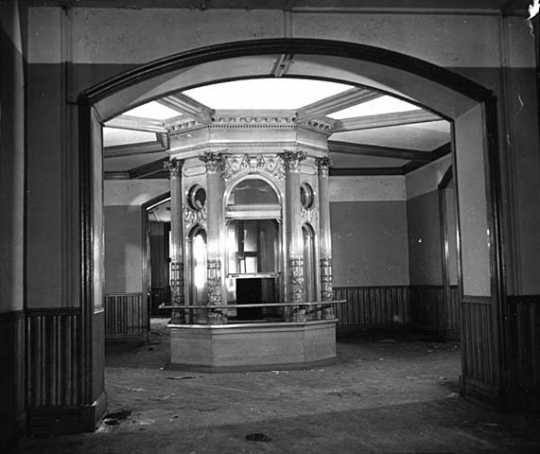 Black and white photograph of the flag case in the rotunda of the second capitol prior to demolition, 1937. Photographed by the Minneapolis Star Journal.