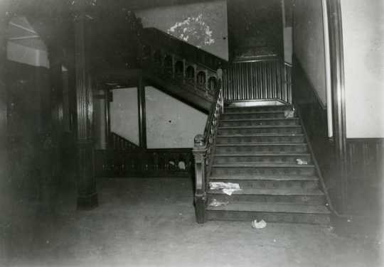 Black and white photograph of the stairway leading to the second floor of the second state capitol building prior to demolition, 1937. Photographed by A.F. Raymond.