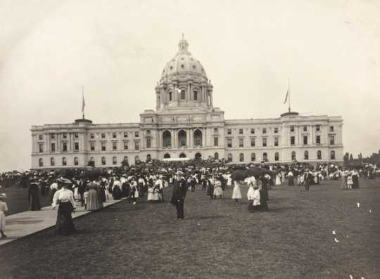 Black and white photograph of the Minnesota Capitol before the installation of the Quadriga, possibly during the dedication ceremony, 1905.