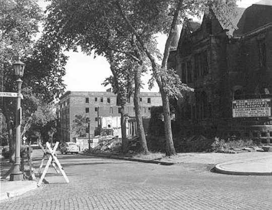 Black and white photograph of St. Paul's Central Park, c.1956. Its view looks south along Central Park Place West; the former Blood mansion is in the foreground.