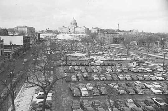 Black and white photograph of the Capitol approach, with Wabasha Street on the left, Cedar Street on the right, showing the site of the second state capitol as a parking lot, 1954.