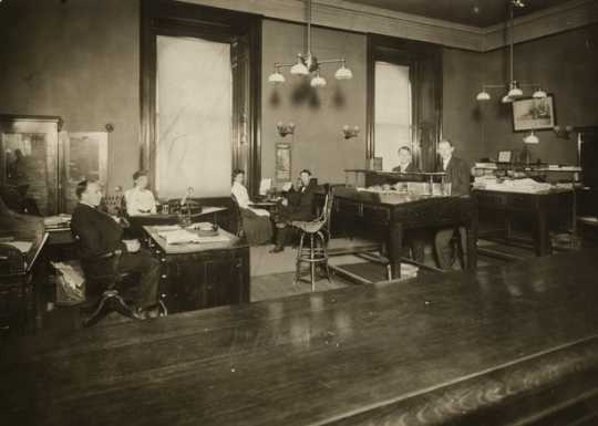 Black and white photograph of the Railroad and Warehouse Commission office in the second state capitol, ca. 1903.