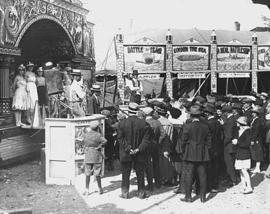 Black and white photograph of sideshows at the Minnesota State Fair, 1917.
