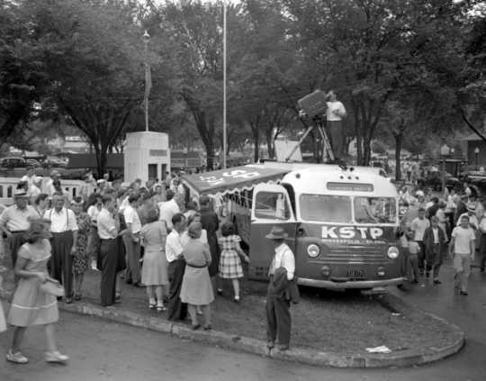 Black and white photograph of Minnesota State Fair-goers at KSTP television cameras of the telemobile, 1947.