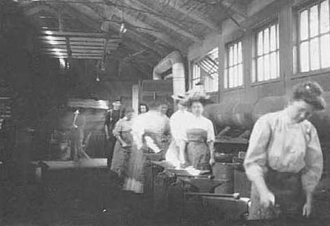 Black and white photograph of an Agriculture Extension, short course in Blacksmithing; women at the forges, 1908.