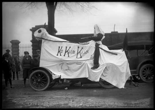 University of Minnesota Homecoming display with Ku Klux Klan banner, ca. 1923.