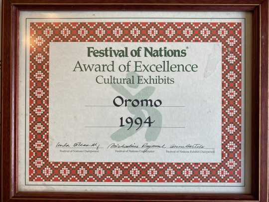 Award presented to the designers of a Oromo cultural exhibit at the Festival of Nations