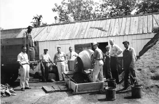 Black and white photograph of men working on a fair building at the Murray County Fairgrounds in Slayton, 1950s.