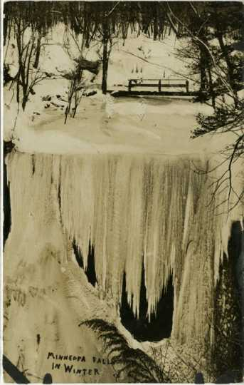Blacka nd white photograph of of Minneopa Falls on the Minneopa River in winter, ca. 1920.