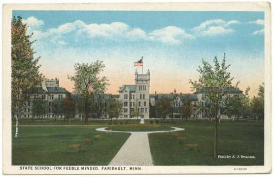 Postcard depicting the exterior of the Faribault State School for the Feeble-Minded in 1920. Photograph by A. J. Swanson.