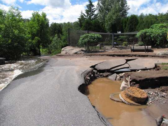 Photograph of flood damage to the Lake Superior Zoo
