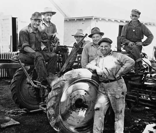 Black and white photograph of German prisoners of war operating farm equipment in Moorhead, ca. 1943–1945. Used with the permission of the Historical and Cultural Society of Clay County.
