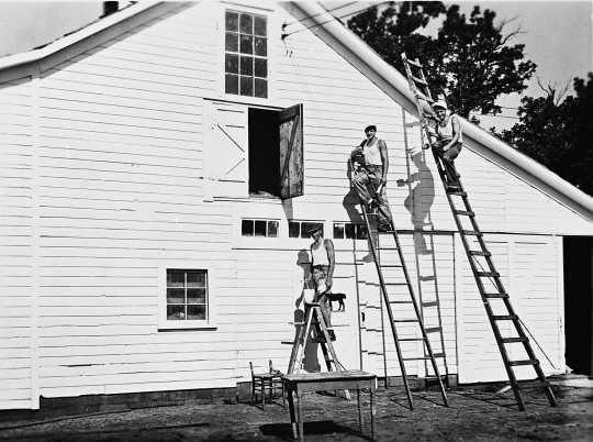 Black and white photograph of German prisoners of war painting a barn in Moorhead, ca. 1943–1945. Used with the permission of the Historical and Cultural Society of Clay County.