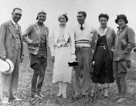 Black and white photograph of Klingensmith, second from left, at the National Air Races, at which she won the Amelia Earhart Trophy, 1932.