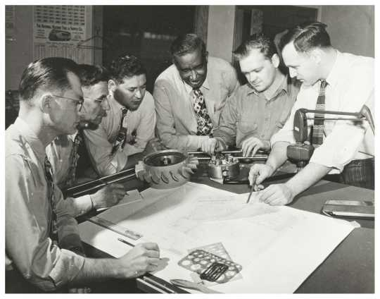 Black and white photograph of Frederick McKinley Jones and drafting team, c.1960.