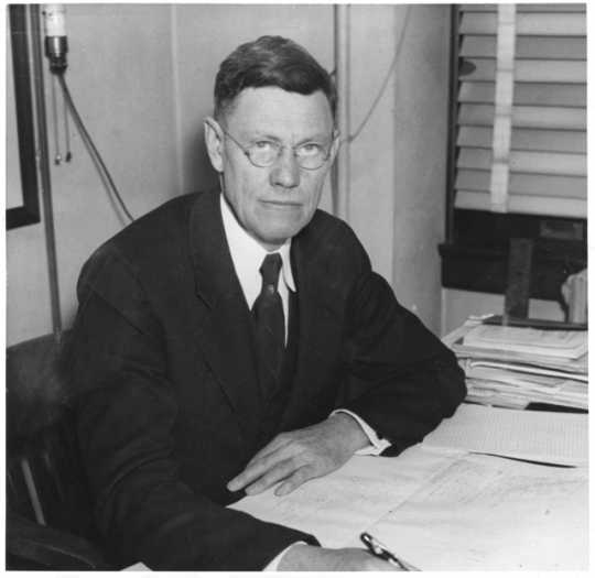 Dr. Frederick Kuhlmann, Director of the Division of Research under the State Board of Control. Photograph for the St. Paul Daily News, ca. 1930.