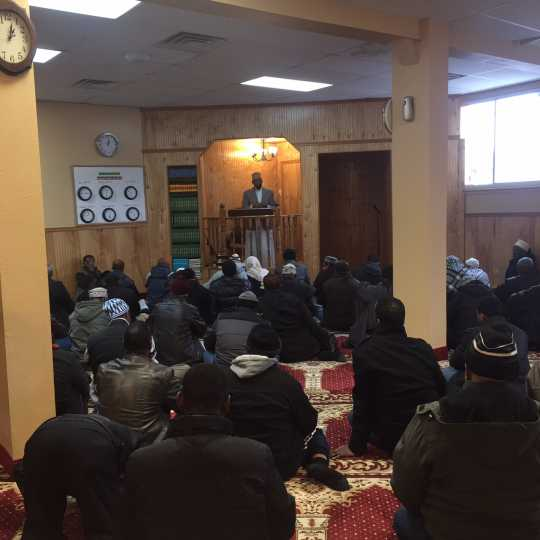 Color image of Friday prayer at Dar Al-Hijrah Mosque, 2015.