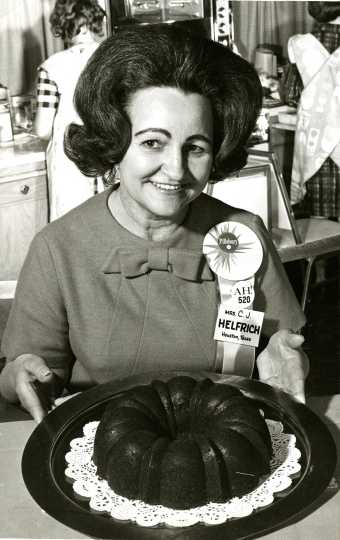 Black and white photograph of Ella Helfrich and her prize-winning Tunnel of Fudge Bundt cake, 1966. Used with the permission of General Mills, Inc.