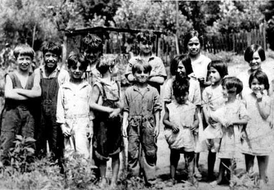 Black and white photograph of children in Swede Hollow, 1935.