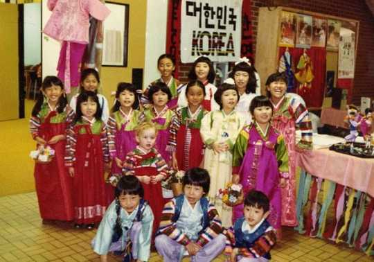 Color image of adopted Korean children in costume at Dual Heritage Conference, 1981.
