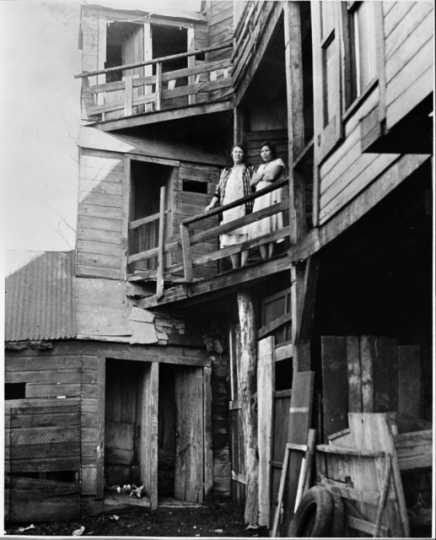 Black-and-white photograph of a three-story outhouse on State Street, c.1940.