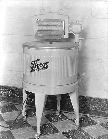 "Black and white photograph of a ""Thor"" brand electric washing machine, ca. 1930s. Photographed by Lee Brothers."