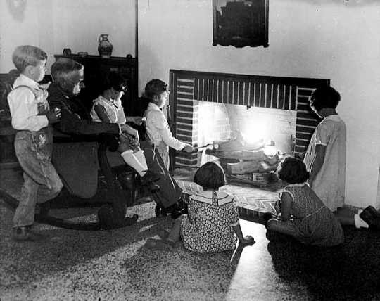 Black and white photograph of Dr. Henry Longstreet Taylor entertaining children at the Ramsey County Preventorium, c.1930.