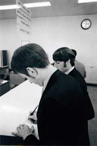Black and white photograph of Jack Baker and James Michael McConnell applying for a marriage license in Minneapolis, 1970.