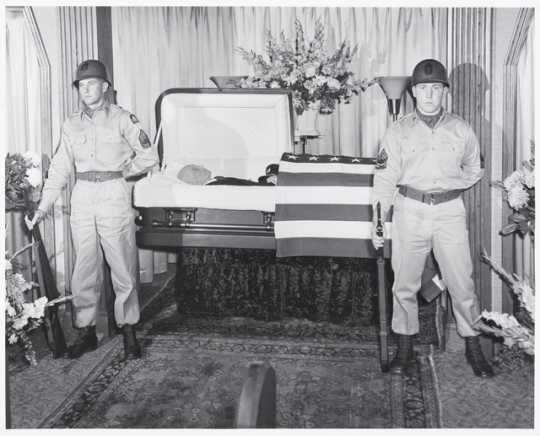 SFC Donald A. Anderson and M/Sgt. Leslie E. Kesti, both of Cloquet, members of Headquarters Battery, 257th Gun Battalion, Minnesota National Guard, serve as sentries of honor at the funeral of the late Albert Woolson (the last Grand Army of the Republic veteran) in a Duluth funeral home on August 4, 1956.