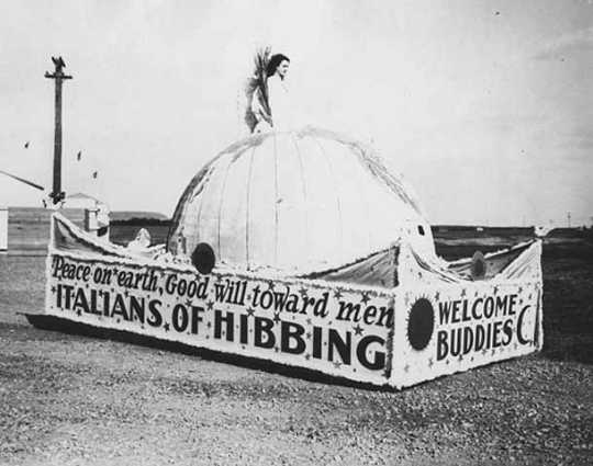 Black and white photograph of a Sons of Italy Fourth of July float, Hibbing, 1930.