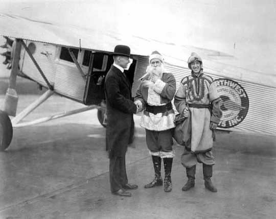 Black and white photograph of Santa Claus arriving via Northwest Airlines for a stay at L.S. Donaldson Company during the Christmas season, 1930.