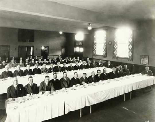 Black and white photograph of a Lions Club meeting at Northeast Neighborhood House, 1926.