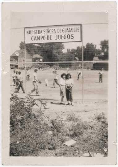 Children playing softball at the playground of Our Lady of Guadalupe Church