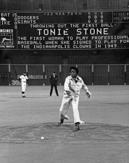 Black and white photograph of Toni Stone throwing out the first ball at a game in San Francisco, c.1965.
