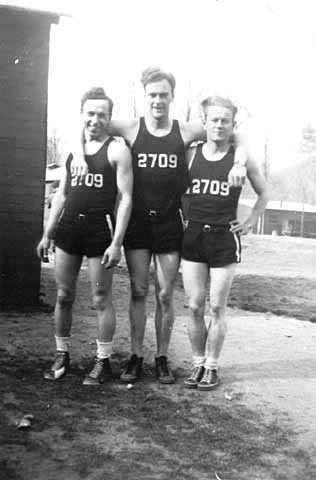 Black and white photograph of basketball players, Civilian Conservation Corps Company 2709, Whitewater State Park. Left to right: Joe Lewis, Frederick K. Johnson, and Carl Lund, 1935.