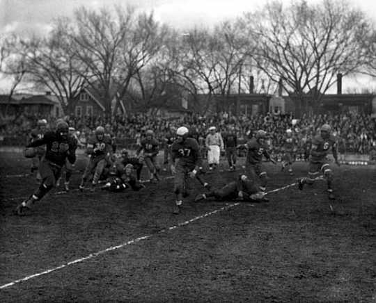 Black and white photograph of a football game at Phyllis Wheatley House, 1940.