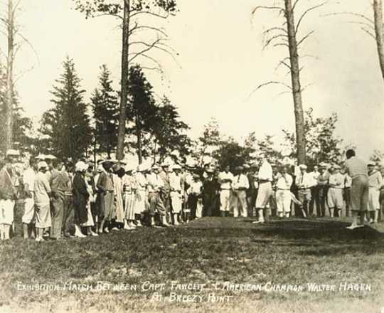 "Photograph of an exhibition golf match between Wilford ""Captain Billy"" Fawcett and American champion Walter Hagen at Breezy Point Resort, 1926."