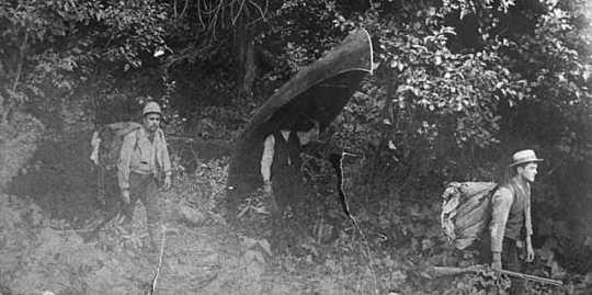 Black and white photograph of from left to right: Leonidas, John, and Bert Merritt exploring, 1890.