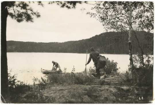 Canoers completing a portage in the Superior National Forest