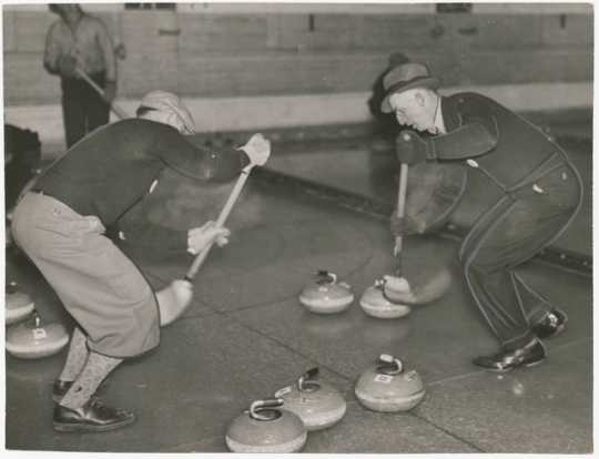 A curling game, 1937. Curling was introduced to Minnesota in the 1850s. Shown is action ca. 1935.