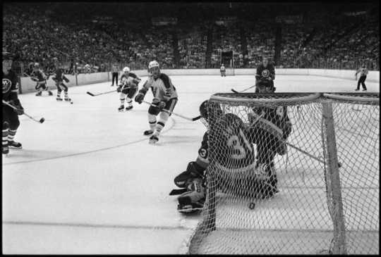 The Minnesota North Stars hockey team in action against the New York Islanders, 1981. The North Stars played in their first Stanley Cup finals against the New York Islanders in that year and lost the series 4-1.