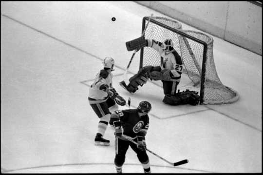 The Minnesota North Stars' goalie Gilles Meloche defends a shot on goal by the Islanders' Anders Kallum in a Stanley Cup finals game at the Met Center in 1981.